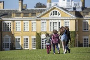 family walking in the gardens at Polesden Lacey, Surrey.